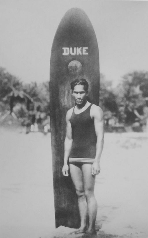 Duke Paoa Kahanamoku with his surfboard https://upload.wikimedia.org/wikipedia/commons/