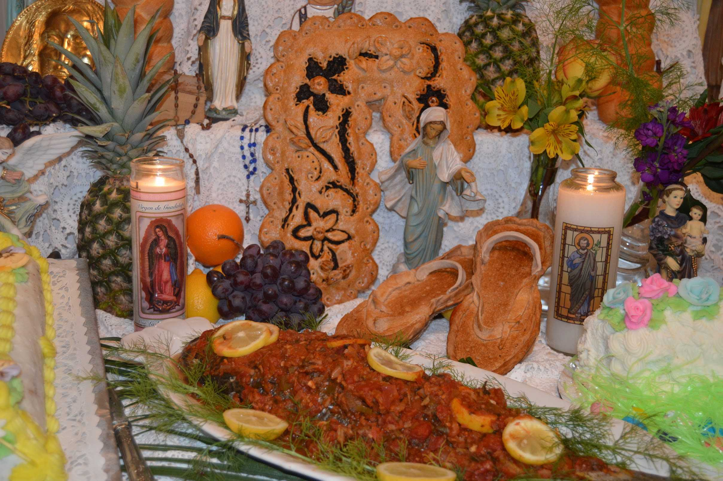In+keeping+with+tradition%2C+flowers%2C+fish%2C+fruit%2C+vegetables%2C++and+wheat+products+in+the+form+of+decorative+breads+and+pastries+are+placed+on+the+Altar+along+with+statues+and+candles.+