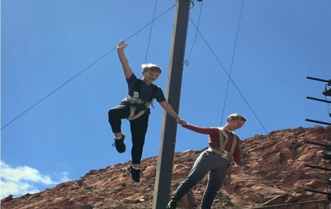 Logan Watts (left) and Em Grosland (right) rehearse a flight sequence for Peter Pan
