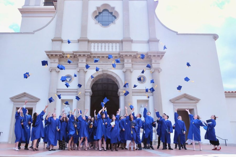 Graduates+joyfully+toss+their+hats+outside+the+Thomas+Aquinas+College+Chapel.+This+year%27s+graduation+will+be+the+third+graduation+for+Mother+of+Divine+Grace.