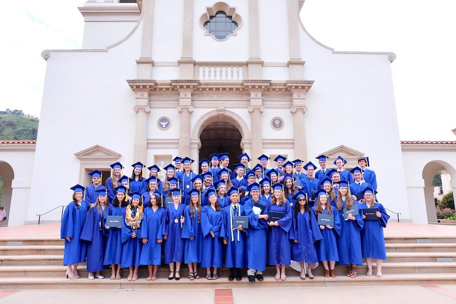 The+MODG+class+of+2019+poses+on+the+steps+outside+of+Our+Lady+of+the+Most+Holy+Trinity+Chapel+on+the+Thomas+Aquinas+College+campus.+