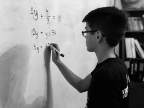 MODG ninth-grader  Jonathan Ledoux works on math at home.
