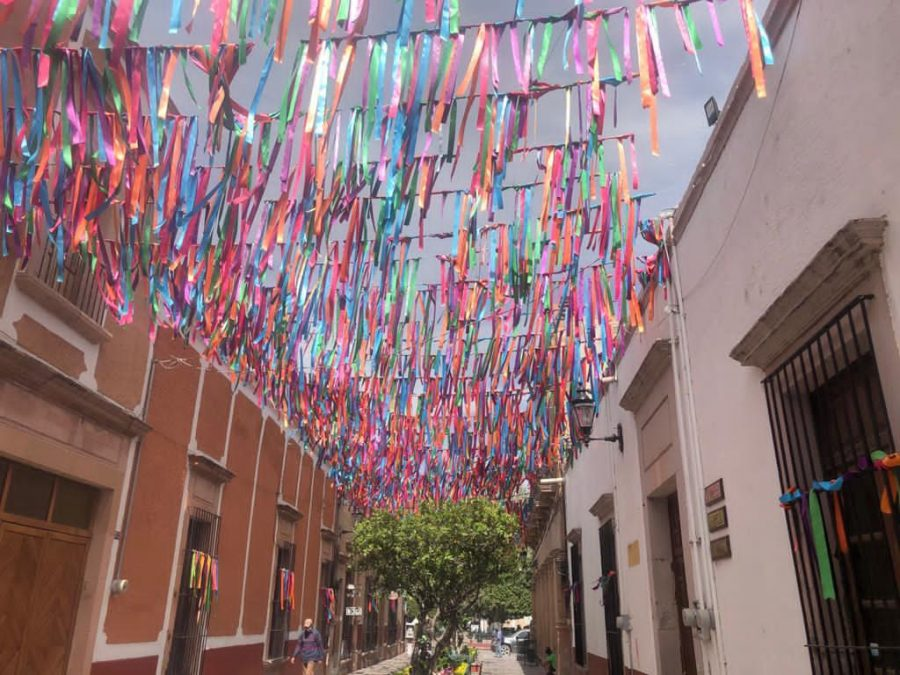 Bright, colorful flags line the walkway in the historic center of Lagos de Moreno.